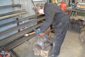 Neil forging a scroll iron